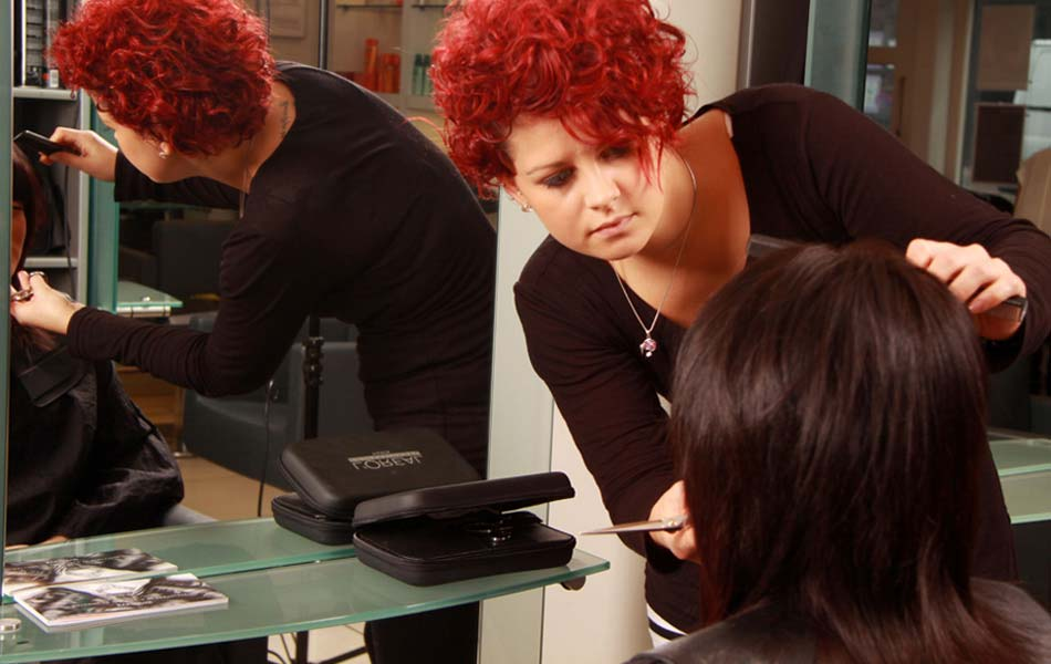 Girl with red hair cutting hair