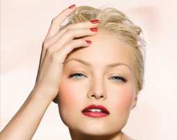 Blonde haired woman with red nails